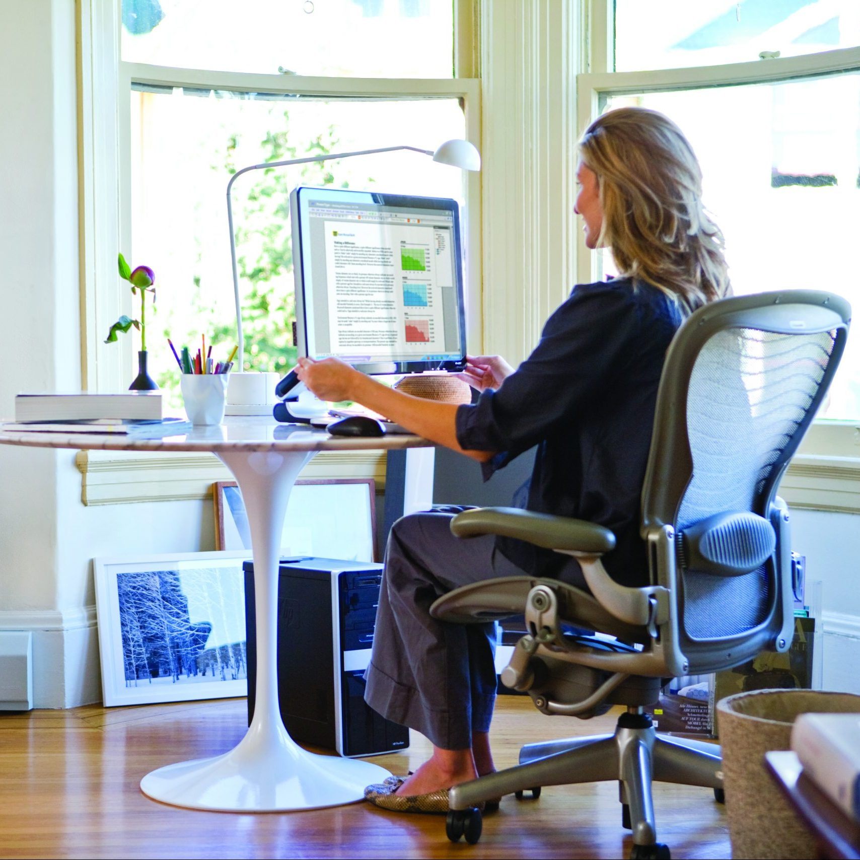 Woman sitting at desk working from home